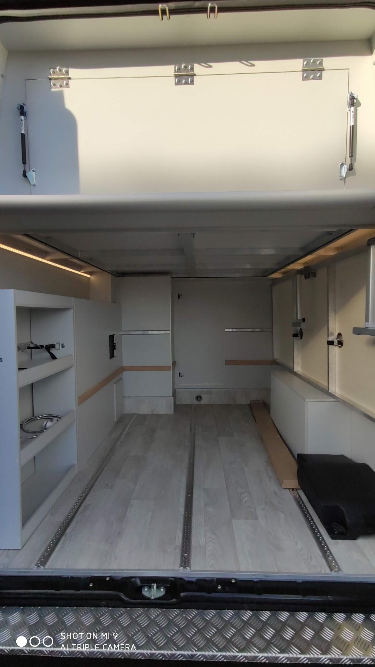 Gästebett Garagenbett zur seite geklappt für Platz in der Garage